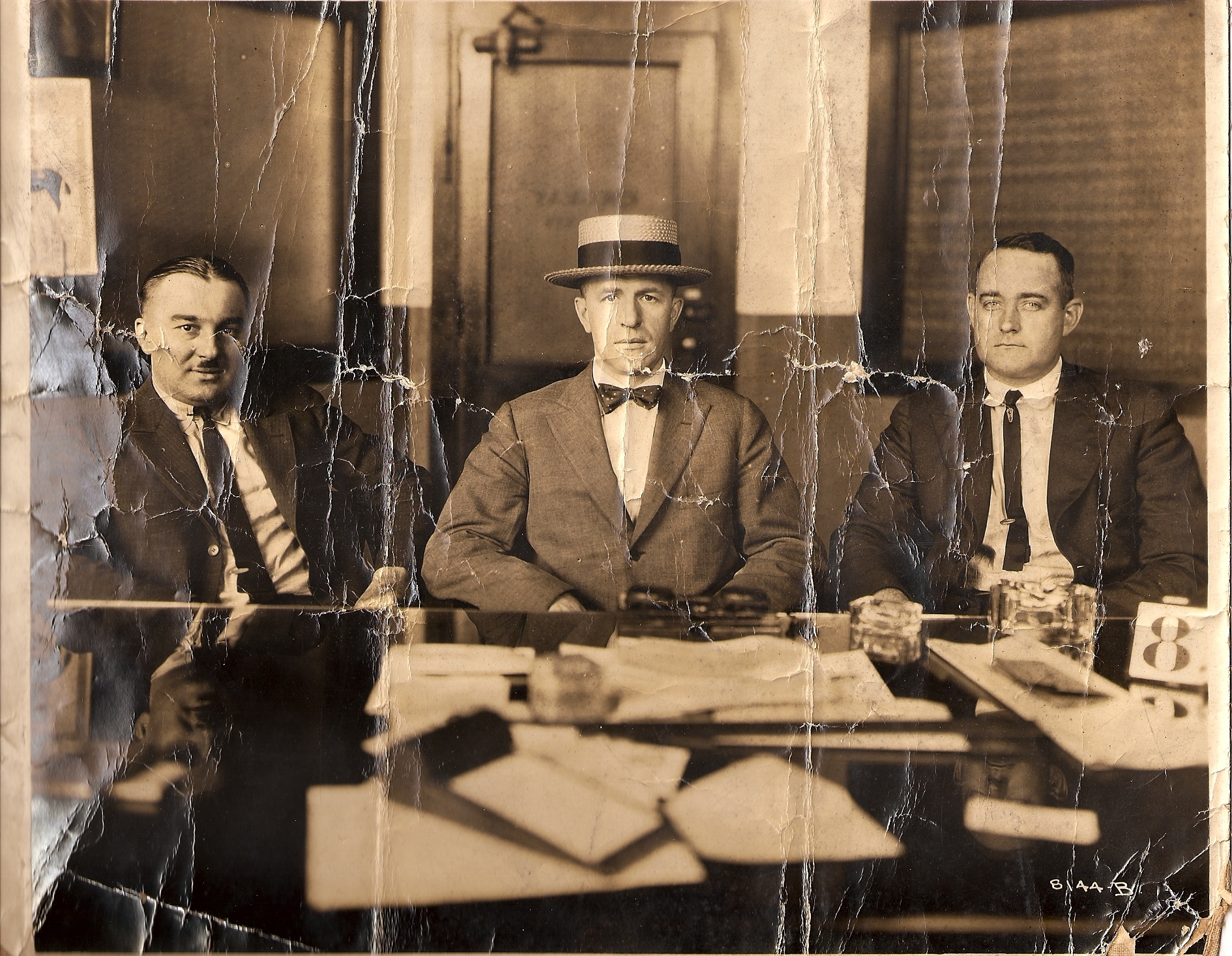 Thomas B. Hogan of the Yellow Cab Company, Chicago Illinois is seated at the center of the photograph.